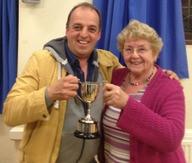 Eddie Humphrey receiving the cup from Penny Riley